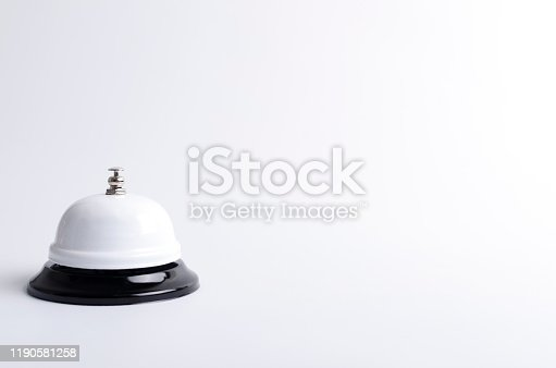 840883328 istock photo Brigth call bell on the white surface.Empty space for text 1190581258
