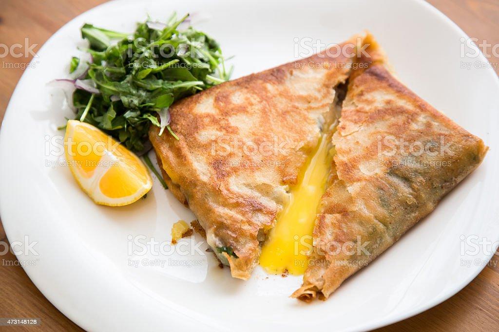 brik, egg and tuna turnover, tunisian food stock photo