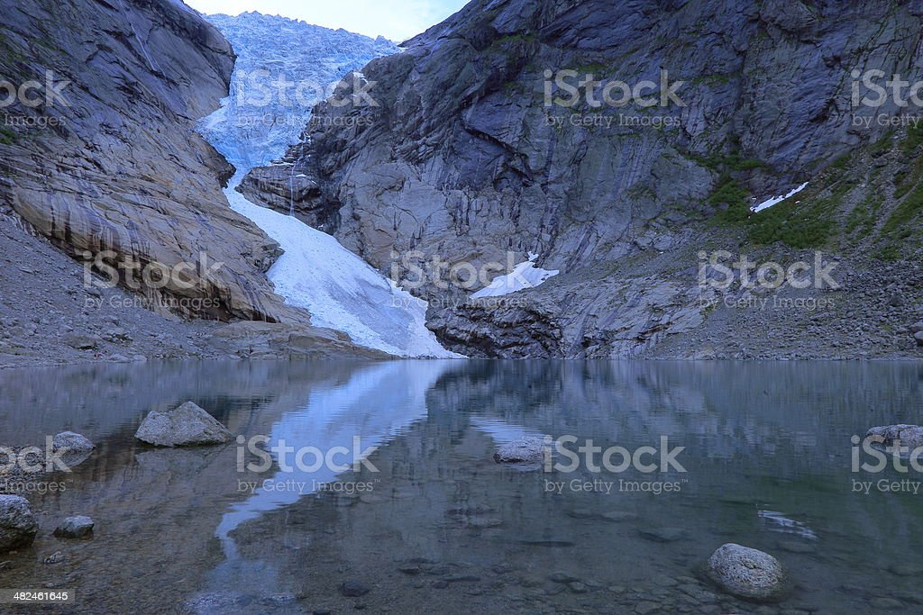 Briksdal Glacier reflection at dusk - Jostedal, Norway stock photo