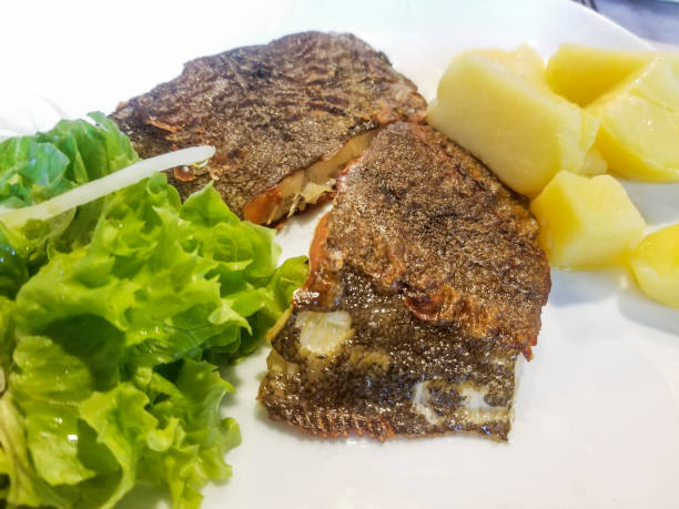 Brill fish with lettuce and potatoes stock photo