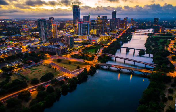 Brilliant Austin city at night nightscape aerial drone view of sunrise with city lights stock photo