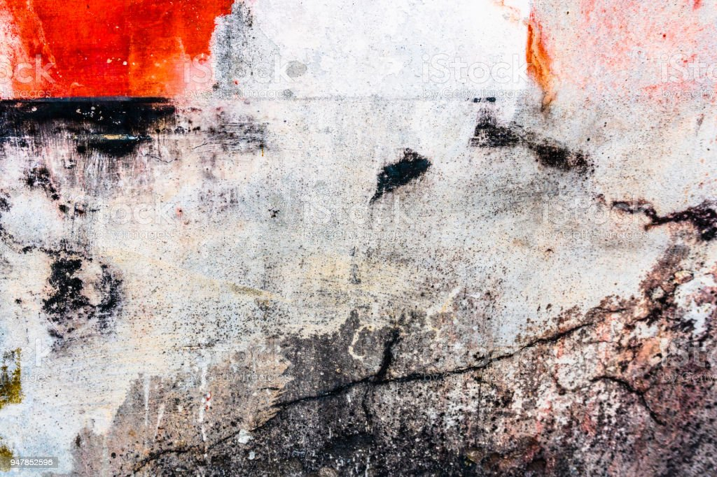 brilliant colorful cracked plaster background in red white and black tones stock photo