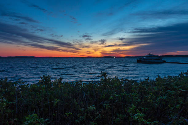 Brilliant colors before sunrise over Frenchman Bay stock photo