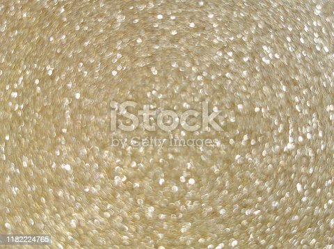 886746424 istock photo Brilliant gold abstract lights background, de-focused 1182224765