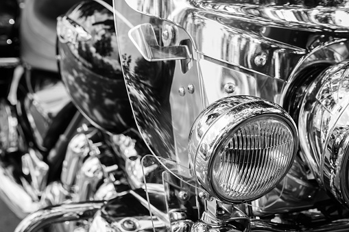 Brilliant headlight motorcycle on a blurry black and white background