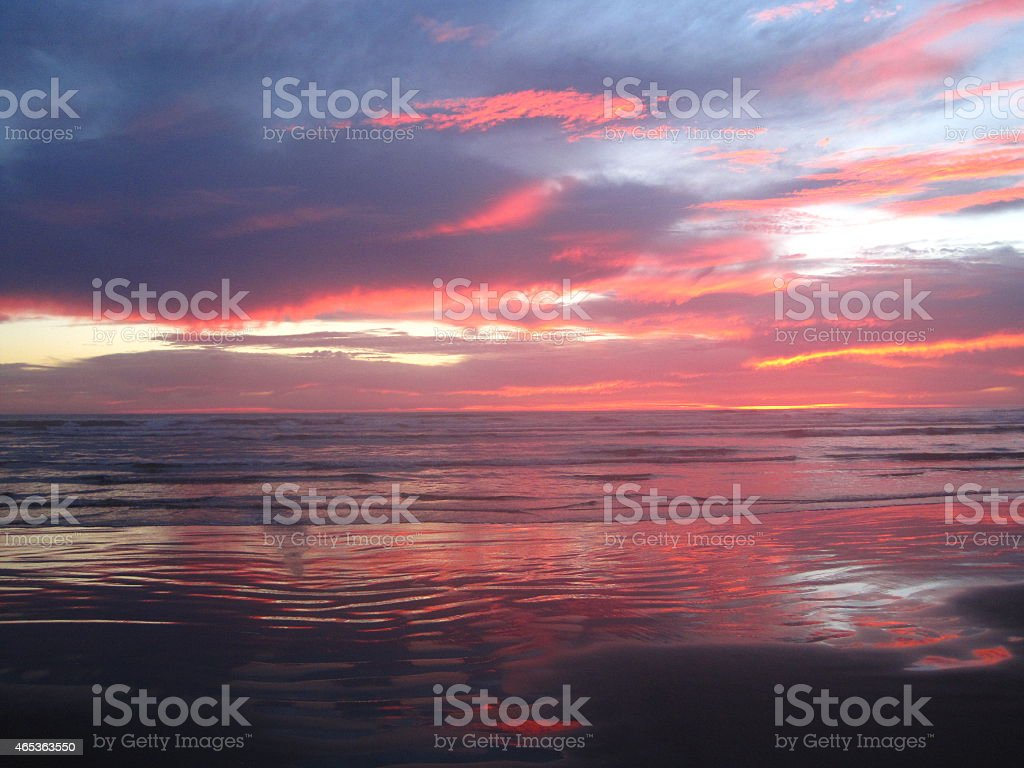 Brilliant Orange and Pink Pacific Beach Sunset stock photo