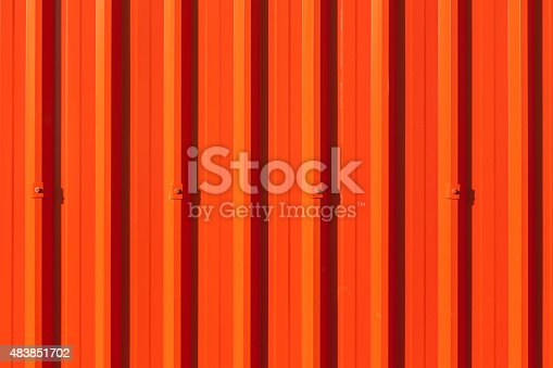 607593268istockphoto Brilliant red corrugated painted metal wall background. 483851702