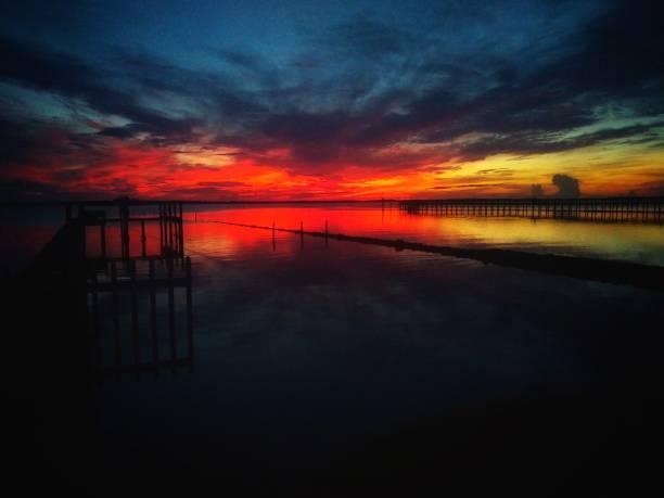 Brilliant red sunset on the Gulf coast of Florida stock photo