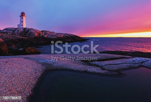 An amazingly colourful sunset at Peggy's Cove Lighthouse.