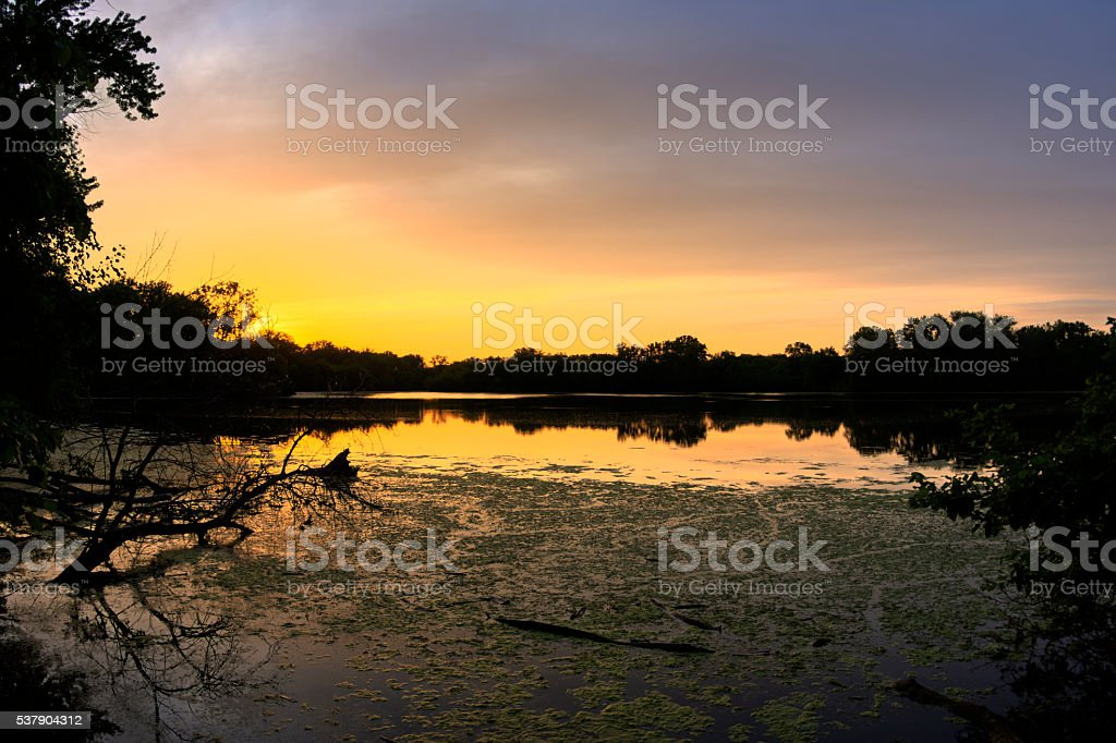 Brilliant sunset over freshwater lagoon stock photo