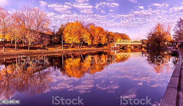 Photo of Brilliant Vibrant Late Autumn Erie Canal Foliage Colors and Reflections