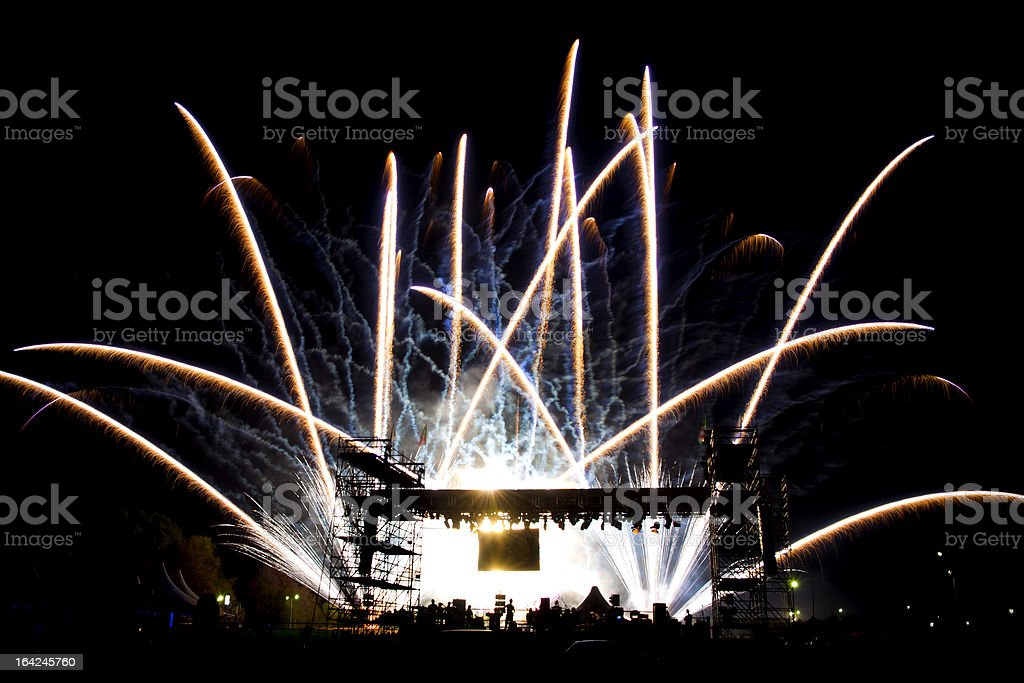 Brilliant White Fireworks Over the Stage of a Concert stock photo