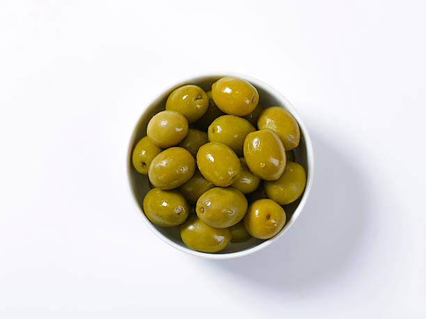 Brine-cured green olives Bowl of brine cured green olives olives stock pictures, royalty-free photos & images