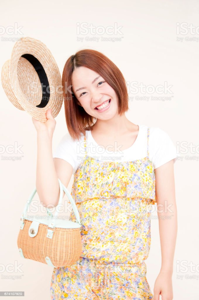 Bring a hat, smiling woman royalty-free stock photo