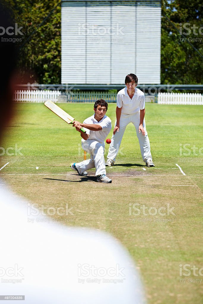 Bring his bat around for a reverse sweep royalty-free stock photo