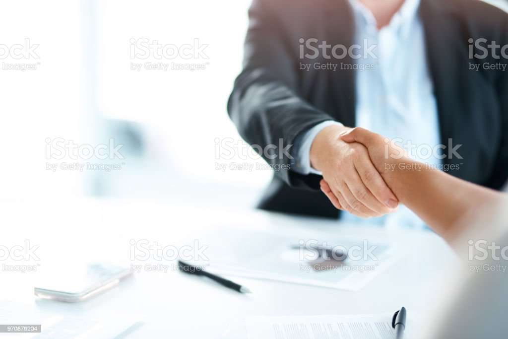 Bring the best, become even better Cropped shot of two businesswomen shaking hands during a meeting in a modern office Adult Stock Photo