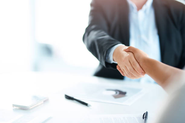 Bring the best, become even better Cropped shot of two businesswomen shaking hands during a meeting in a modern office alliance stock pictures, royalty-free photos & images