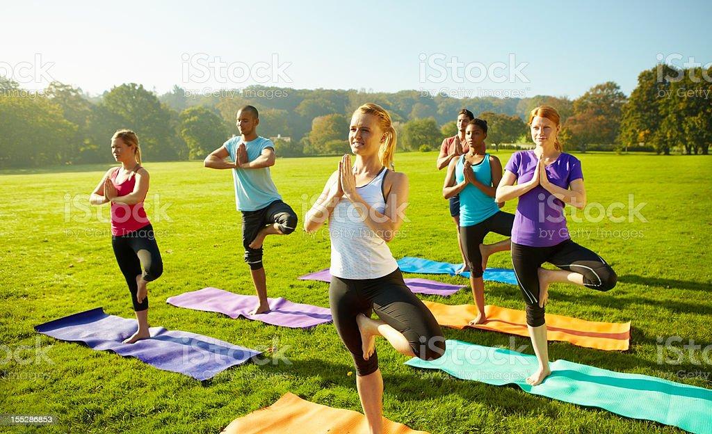 Bringing balance to busy lives - Yoga stock photo