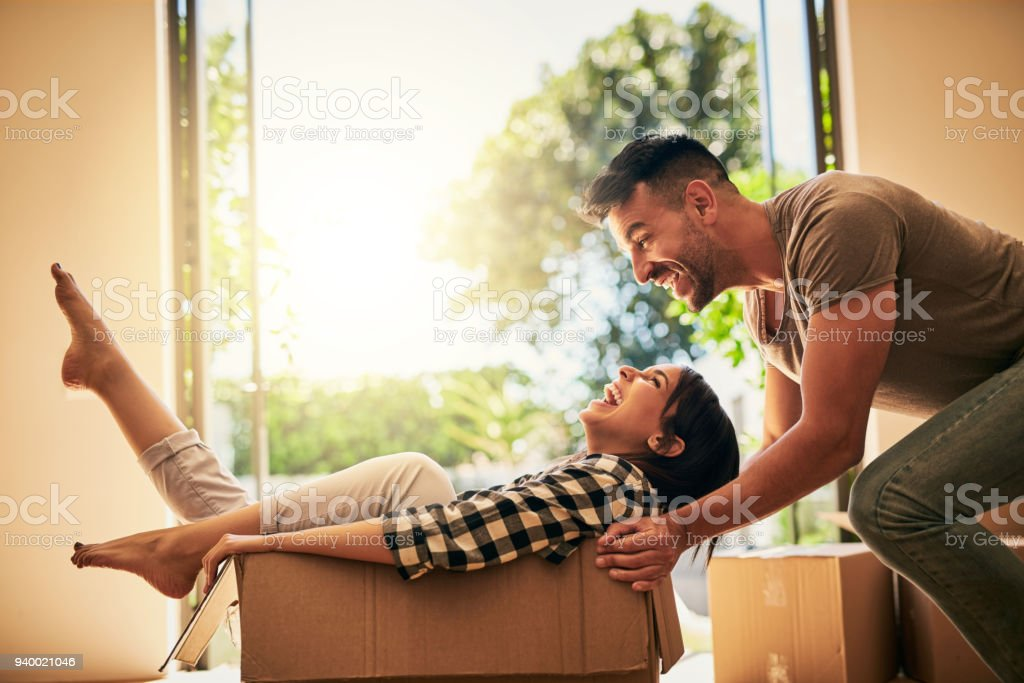 Bringing bits of fun into their new place stock photo