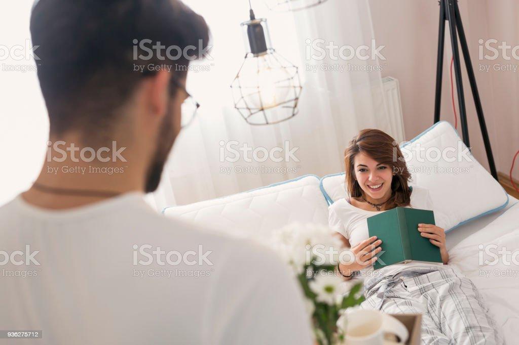 Bringing breakfast on a tray stock photo
