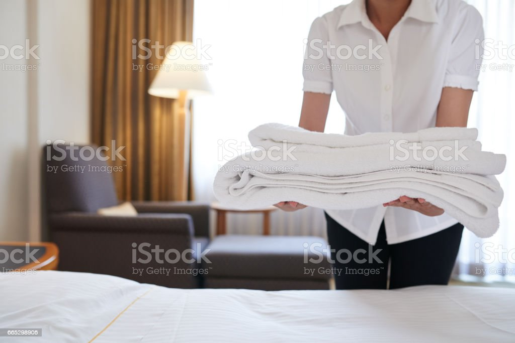 Bringing fresh towels stock photo