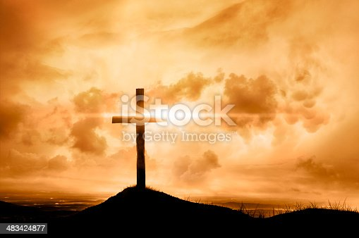 A blazing sunset silhouettes the famous symbol of God's uncompromising love to mankind.