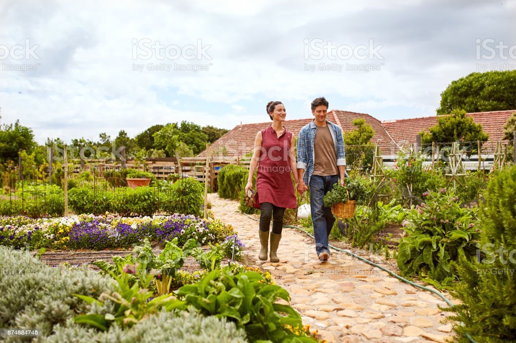 Bringing lots of love to their garden stock photo