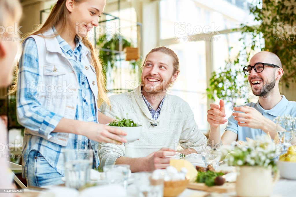 Bringing salad for guests stock photo