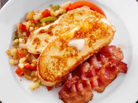 French Toast in Focus with Bacon and Syrup