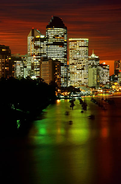 Brisbane city lights reflected in the Brisbane River at twilight stock photo