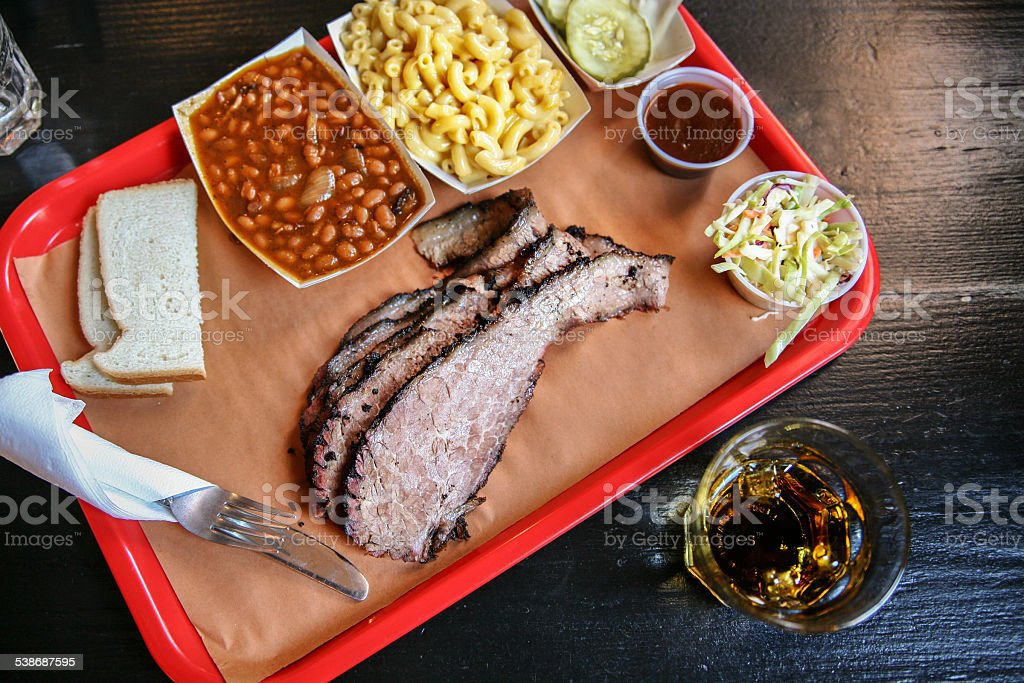 BBQ brisket, sides, and whiskey stock photo