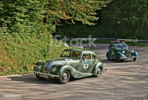 driver and co-driver on a classic British car Bristol 400 (1949) in historical classic car race Mille Miglia, on May 21, 2016 in Passo della Futa (FI) Italy