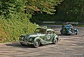 driver and co-driver on a classic British car Bristol 400 (1949) in historical classic car race Mille Miglia, on May 21, 2016 in Passo della Futa (FI) Italy
