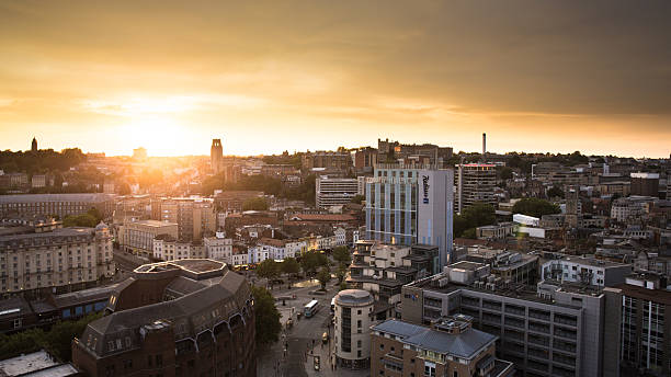 Bristol City Sunset Aerial photo of a sunset over Bristol City Centre, taken from above Queen Square facing towards Wills Memorial Building. somerset england stock pictures, royalty-free photos & images