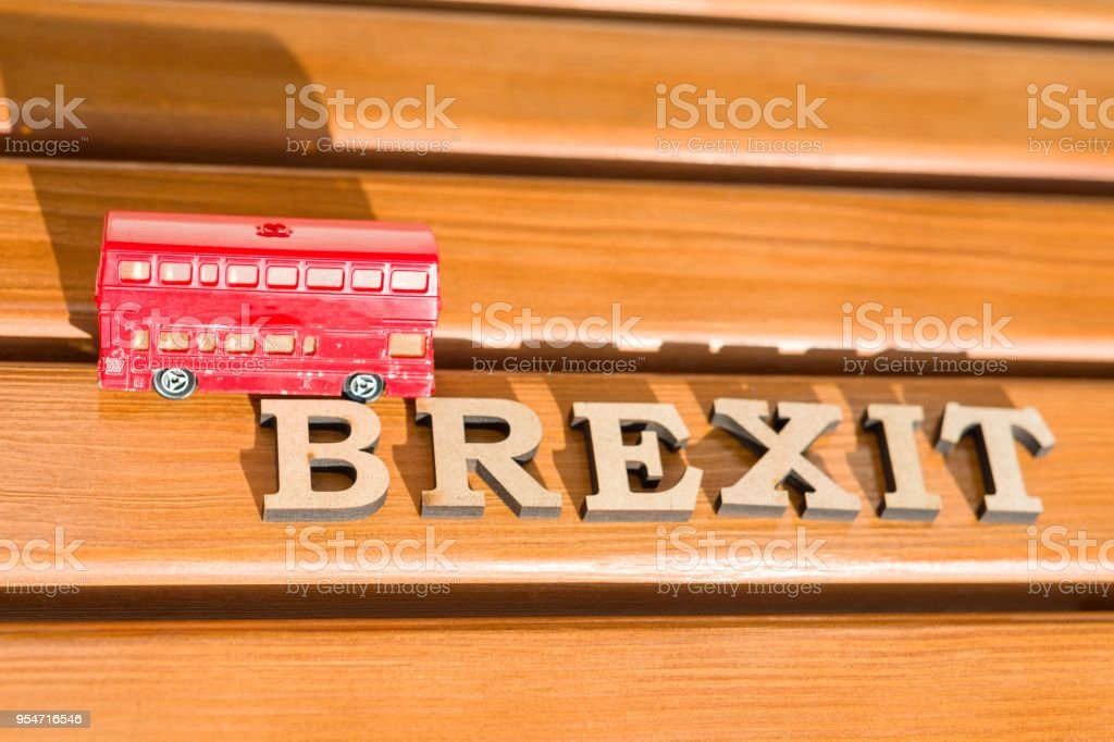 Britain exit from European Union, Brexit word abstract in vintage letters,background double decker bus toy model. stock photo
