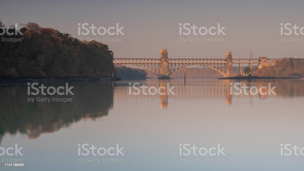 Britannia Bridge Britannia Bridge, Anglesey at Sunrise. Anglesey - Wales Stock Photo