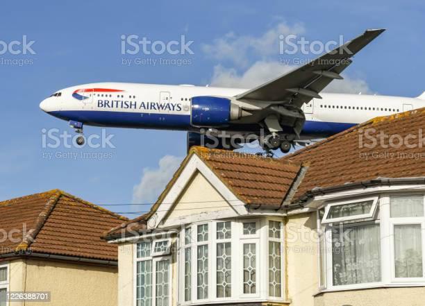 British airways boeing 777 jet flying very low over a house before picture id1226388701?b=1&k=6&m=1226388701&s=612x612&h=k63smkm5quge4lbntv7njmhyjru wkvgs0vb kt77 y=