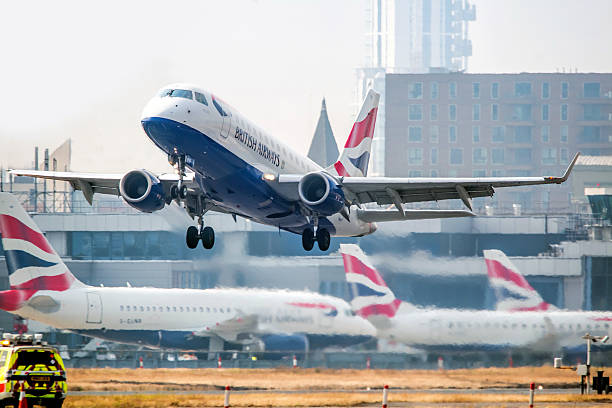 British Airways flight takes off from London City Airport stock photo