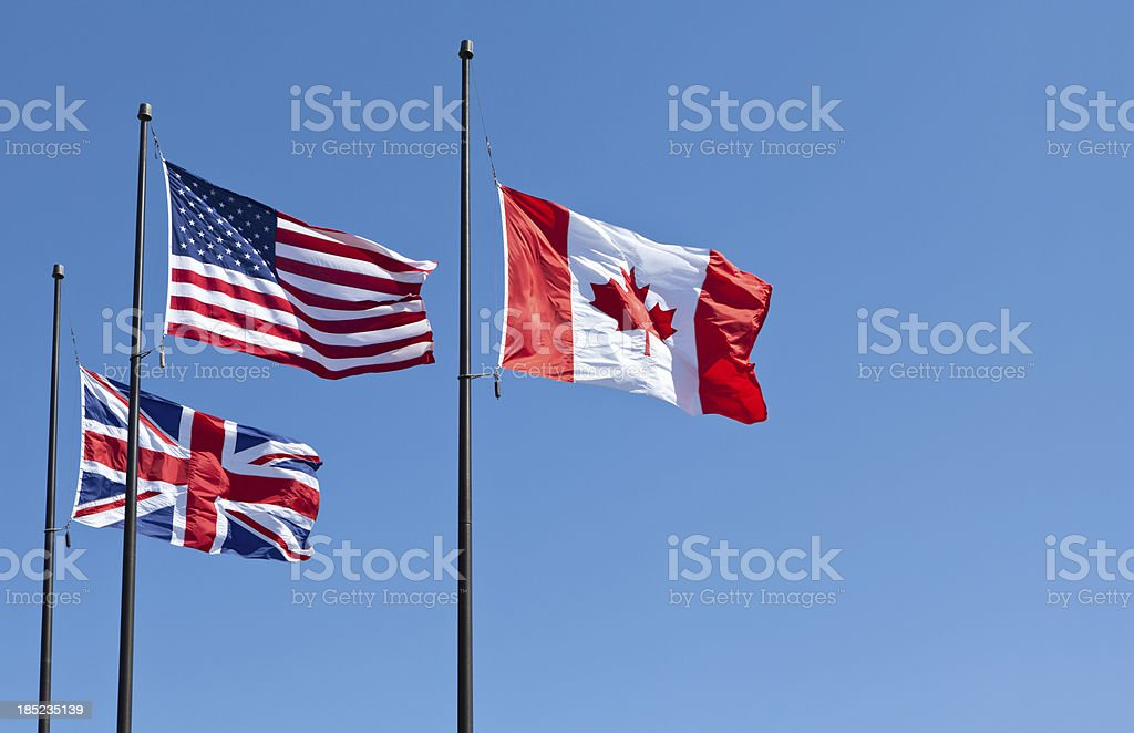 British, American and Canadian Flags stock photo