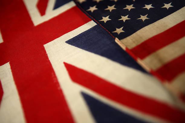 British and American flags laying next to each other stock photo