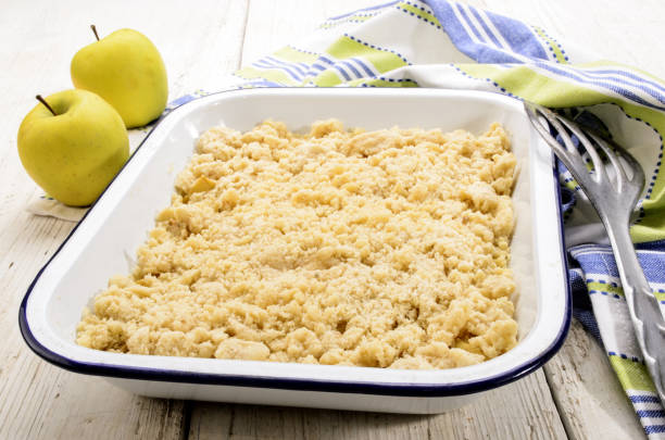 british apple crumble in an enamel bowl stock photo