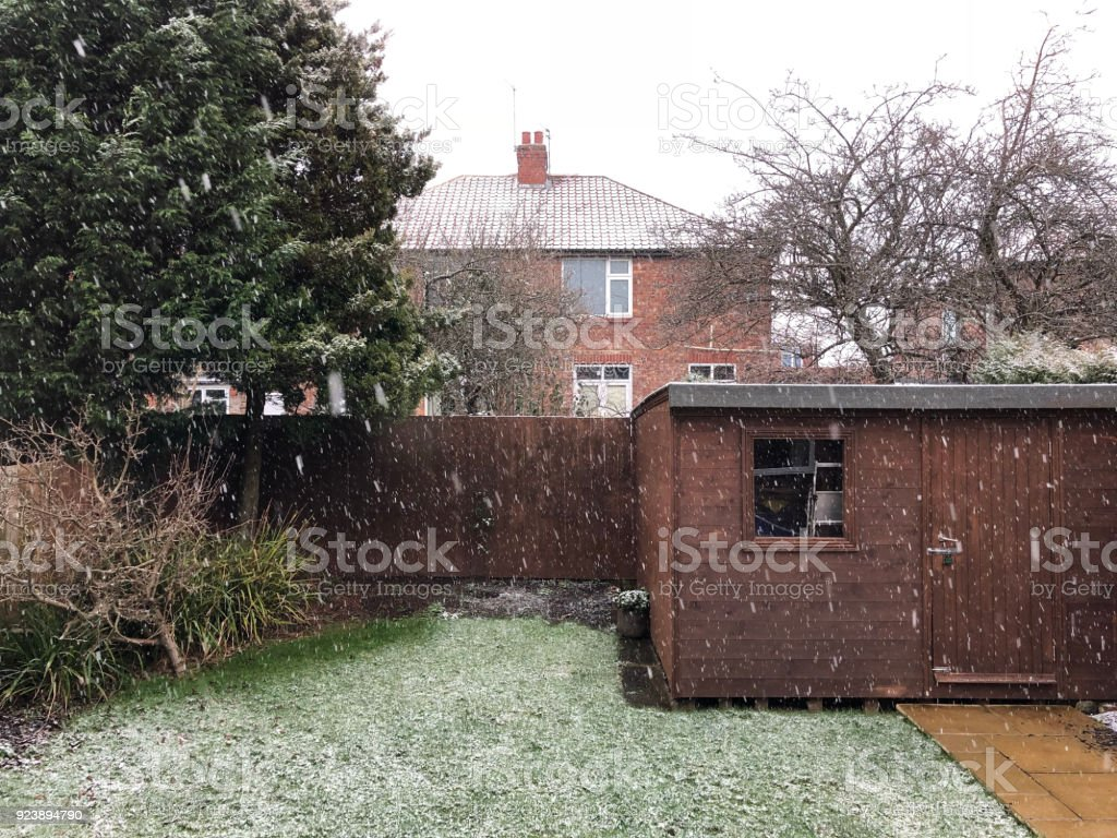 British back garden in snow. stock photo