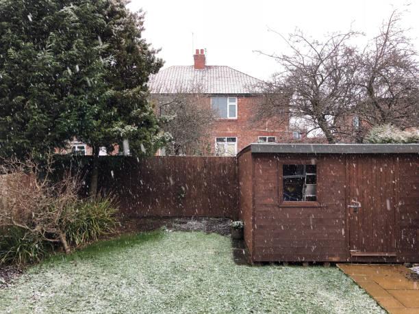 British back garden in snow. stock photo