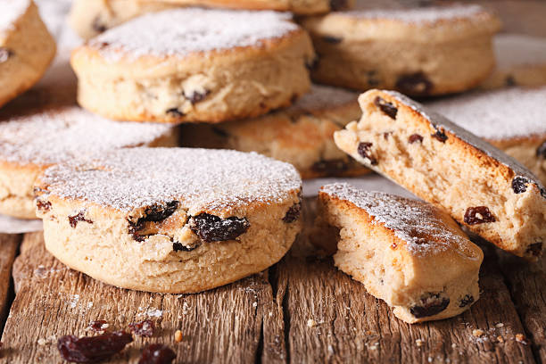 British biscuits: Welsh cakes with raisins and powdered sugar British biscuits: Welsh cakes with raisins and powdered sugar close-up on the table. horizontal welsh culture stock pictures, royalty-free photos & images