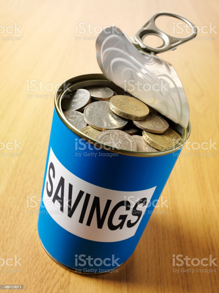 British Coins in a Blue Tin Can for Savings royalty-free stock photo