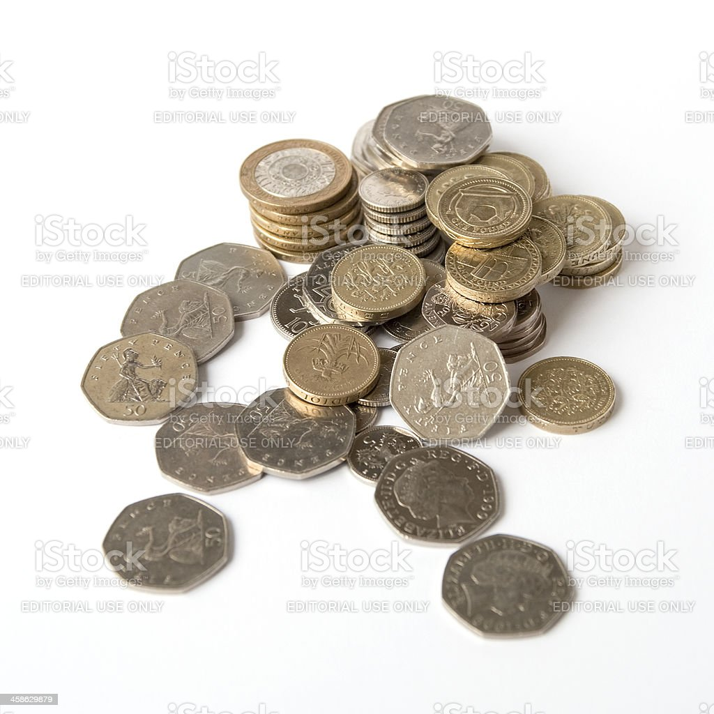British coins in a pile stock photo