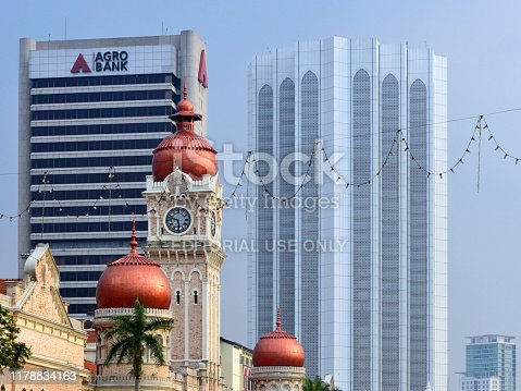 Kuala Lumpur, Malaysia: Sultan Abdul Samad Building, the British colonial Government Offices, built in the 19th century - Ministry of Communications and Multimedia and the Ministry of Tourism and Culture of Malaysia - Indo-Saracenic / Neo-Mughal style - Jalan Raja, Independence Square - Agro Bank tower and Dayabumi Tower in the backround