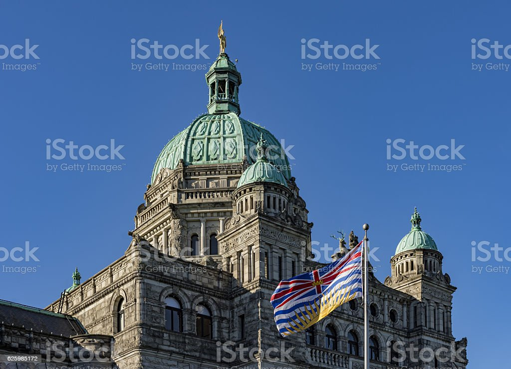 British Columbia Parliament Building and BC Flag Victoria BC Canada stock photo