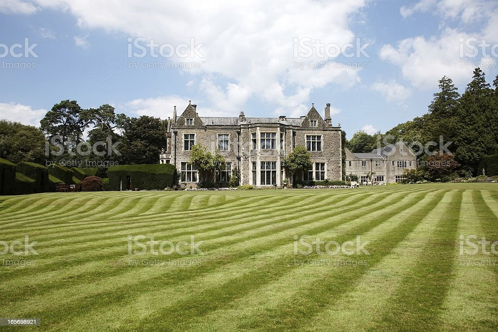 British country mansion lawn view stock photo