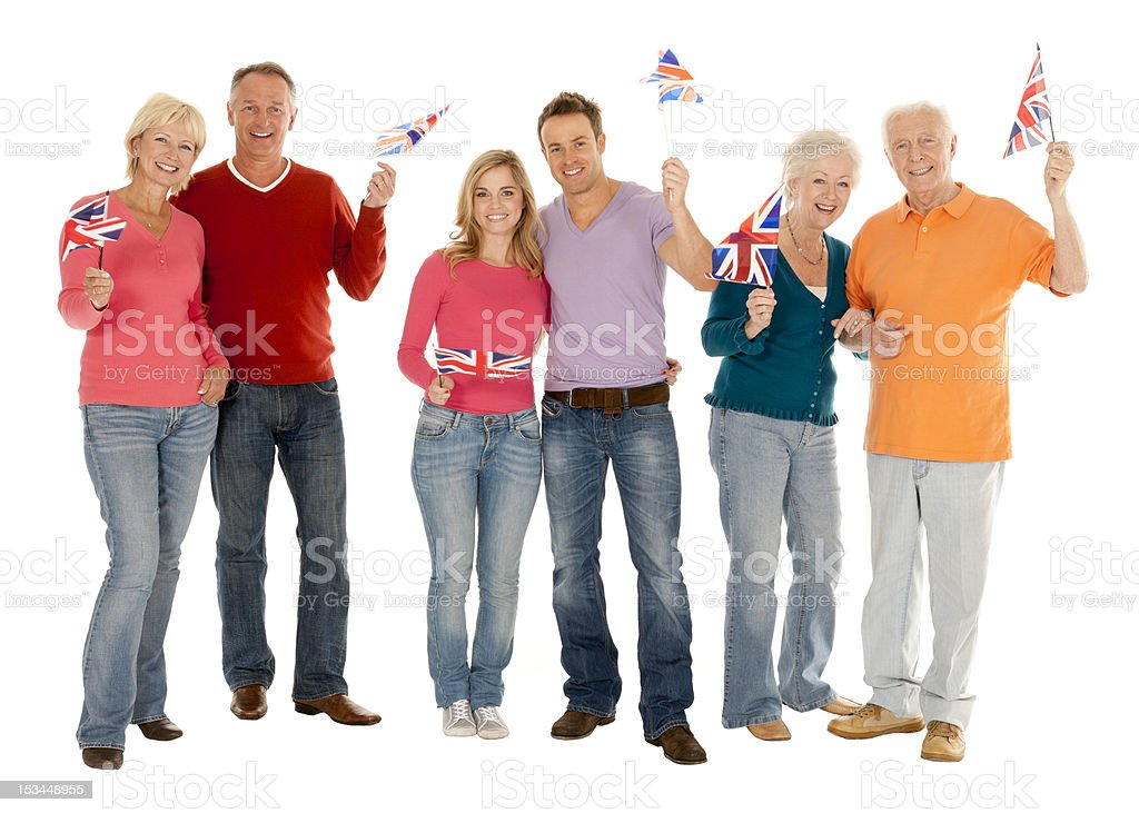 British couples of all ages waving Union Jack Flags royalty-free stock photo